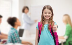 Image of student giving thumbs up.