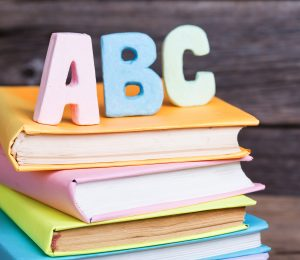 Image of letters ABC stacked on top of books.