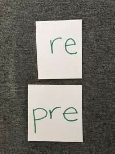 "Image of card with ""re"" and card with ""pre"""